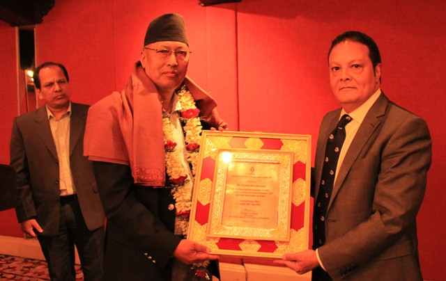 Chairman Mr. Ashoke SJB Rana giving certificate of appreciation to Mr. Shrestha