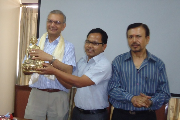 Officiating CEO Mr. Ram Dayal Rajbanshi handing a token of love to Mr. Gajurel.
